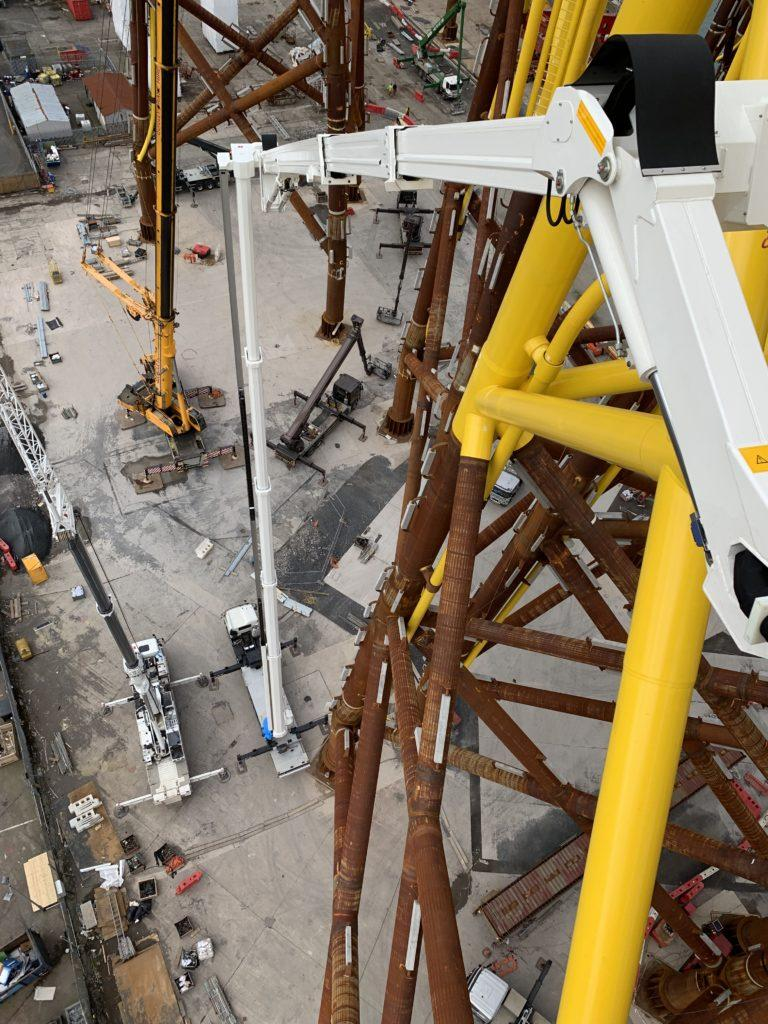 Aerial work platform preparing offshore wind farm jacks
